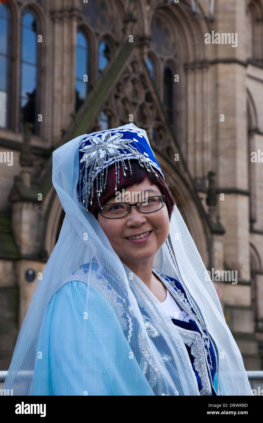 Manchester, Chinatown 2nd February, 2104.  Mrs Nina Fung in traditonal dress at the Chinese New Year in Albert Square, Manchester the North's biggest Chinese New Year celebrations. Manchester's Chinatown is one of Europe's biggest tucked into a narrow grid of streets behind Piccadilly Gardens.  With a 175-foot paper dragon, a lion dance, martial arts demonstrations, the Dragon Parade is one of the highlights of Manchester's annual events calendar. Credit:  Mar Photographics/Alamy Live News. - Stock Image