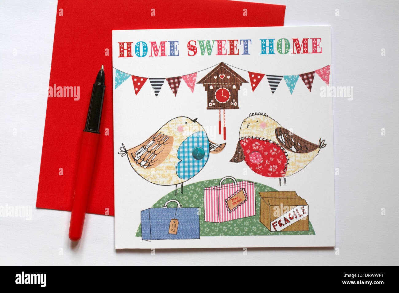 Home sweet home card with pen and red envelope set on white background - Stock Image