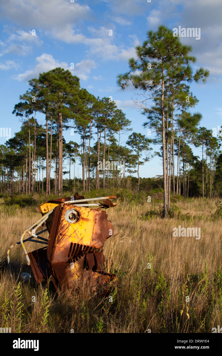 rusting vehicle in an abandoned township - Stock Image