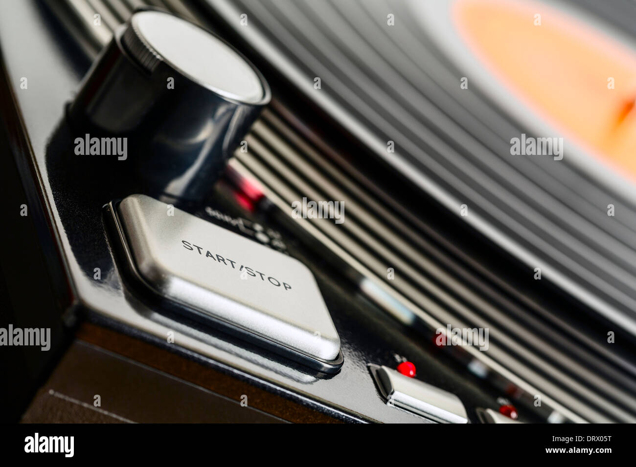 Turntable rotates and start stop button - Stock Image
