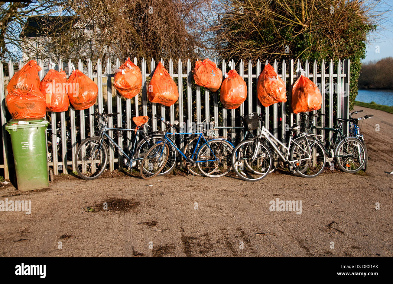 Rubbish Bags and Bicycles - Stock Image