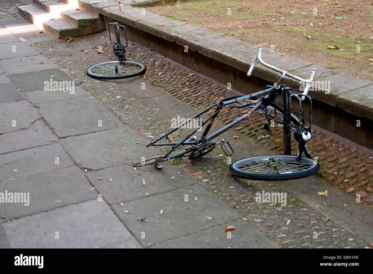 Bicycles, Locked, damaged, theft, vandalism. - Stock Image