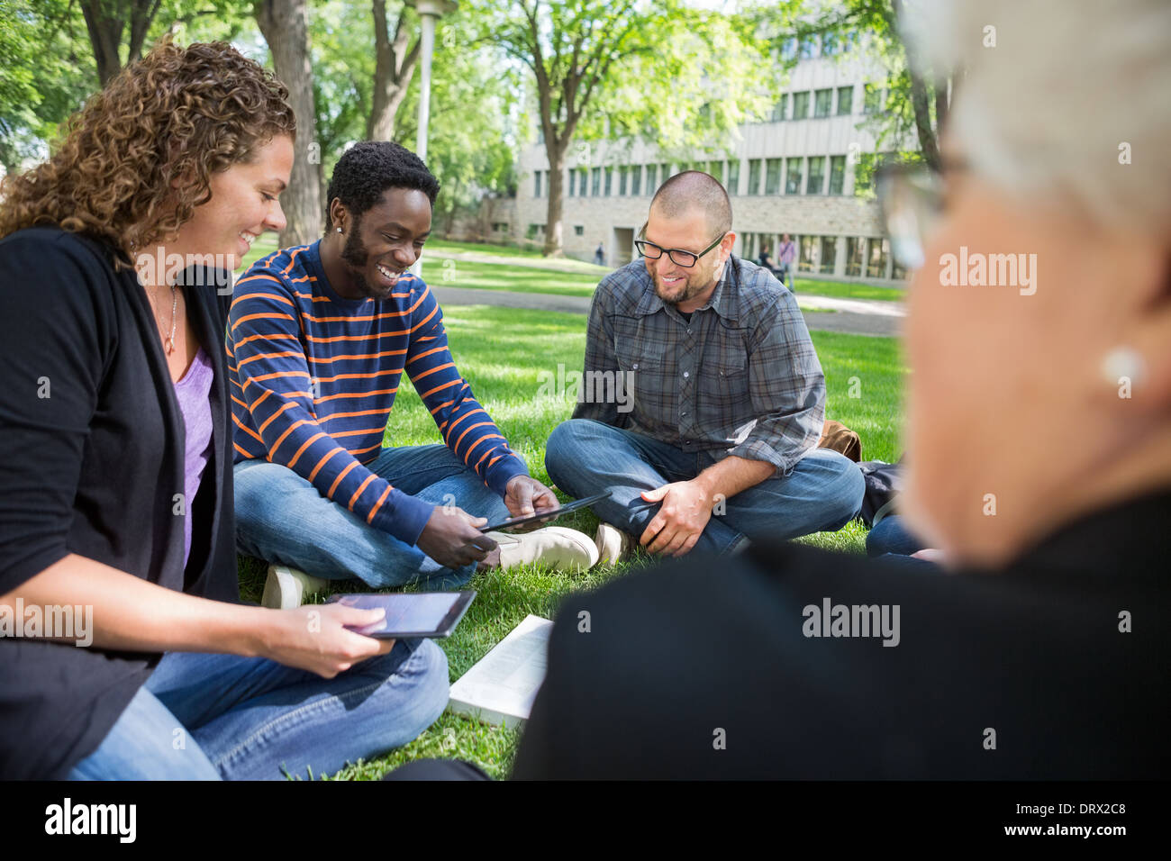 Group Of Students Using Digital Tablet On Campus - Stock Image