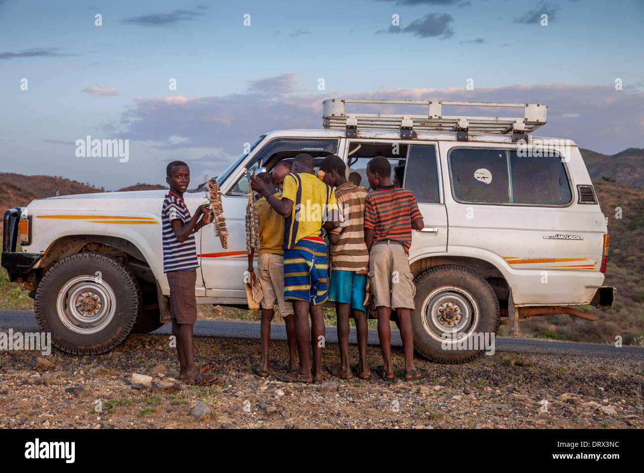 Local Boys Approach A Tourist Vehicle To Sell Handicrafts The Omo
