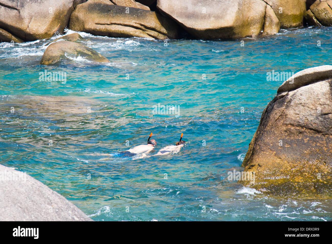 Tourist couple snorkeling in Ao Hin Wong, (Hin Wong Bay), Ko Tao Island, Thailand - Stock Image