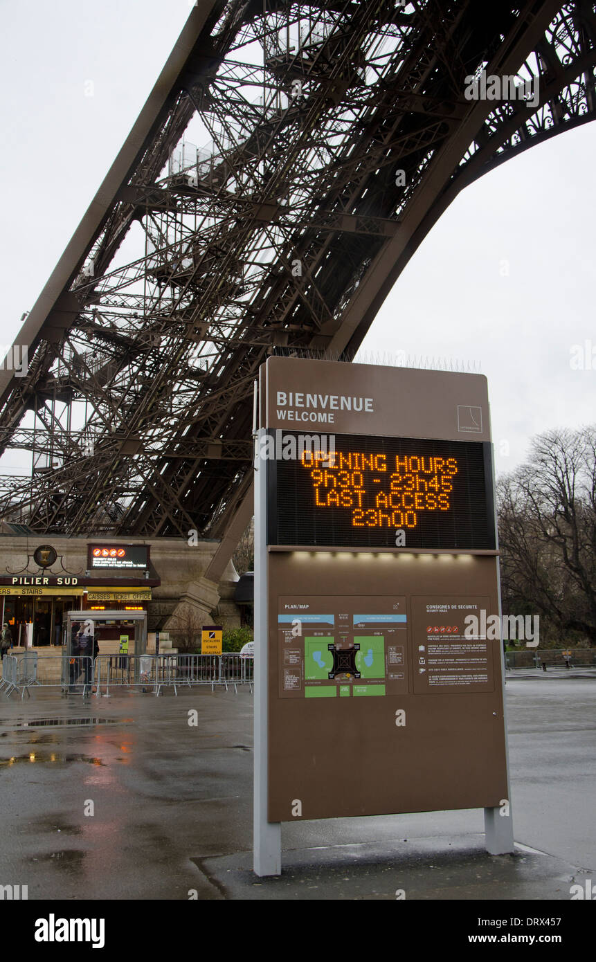 Welcome sign in front of the Eiffel tower with south leg in background. Paris, France. - Stock Image