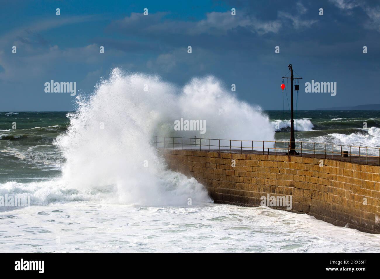 Porthleven Pier; Wave Breaking; Cornwall; UK - Stock Image