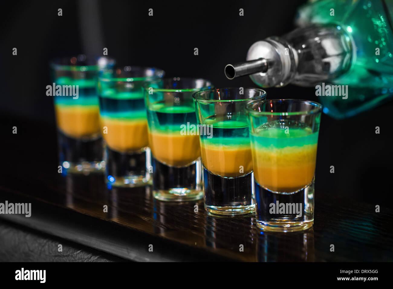 Barman make alcoholic shots in nightclub - Stock Image