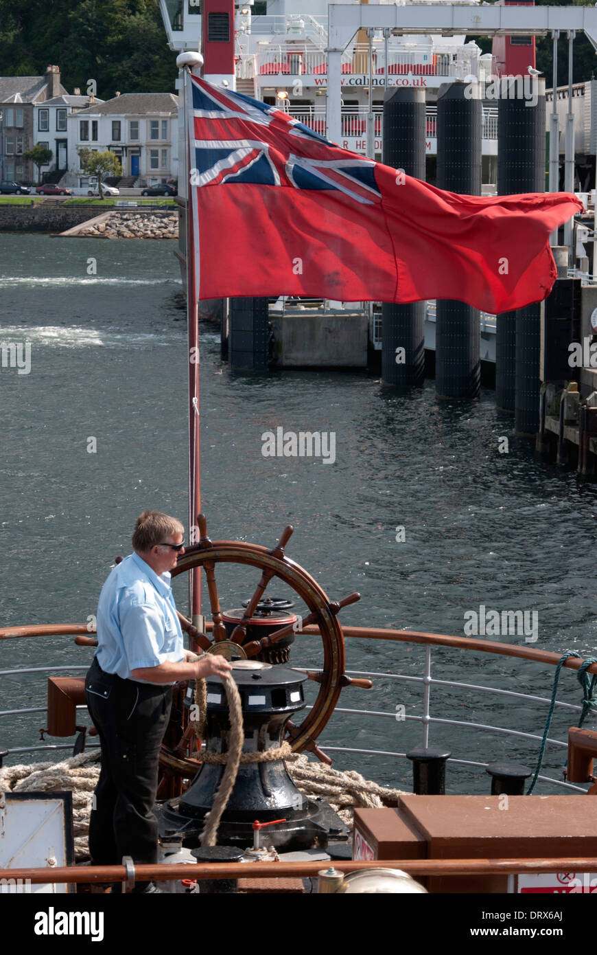 Deckhand on P.S. Waverley Casting Off from Rothesay Pier Isle of Bute Stock Photo