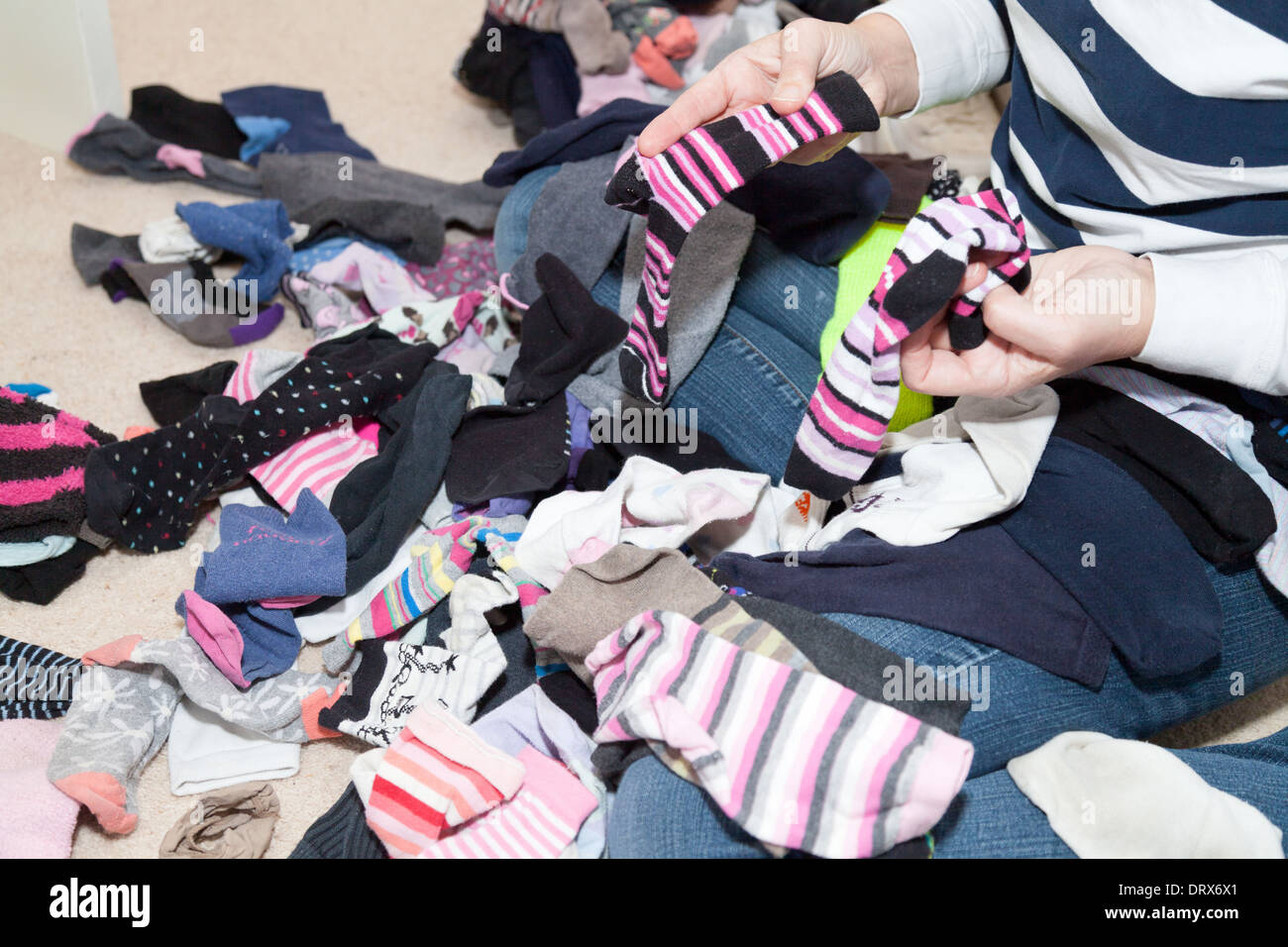 Sorting socks - a common household chore, UK - Stock Image