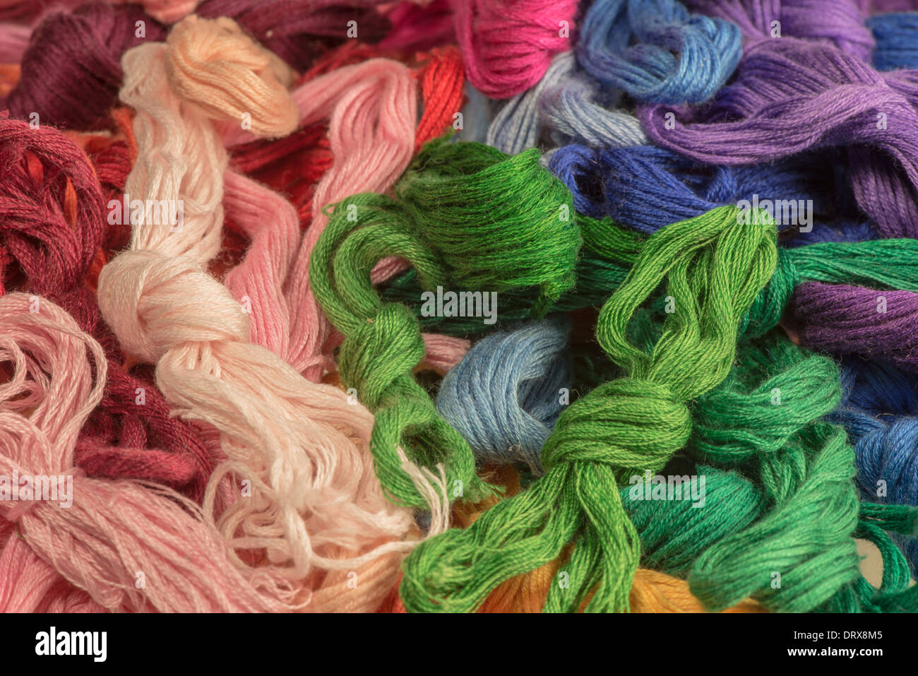 skeins of multicolored threads for embroidery - muline. background - Stock Image