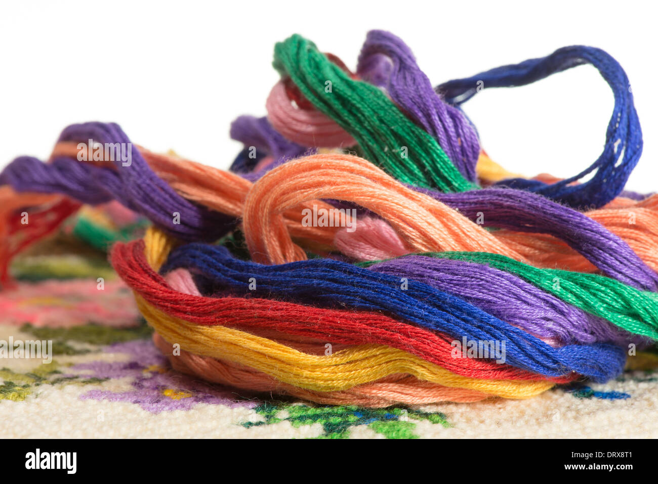 skeins of multicolored threads for embroidery - muline. on a white background - Stock Image