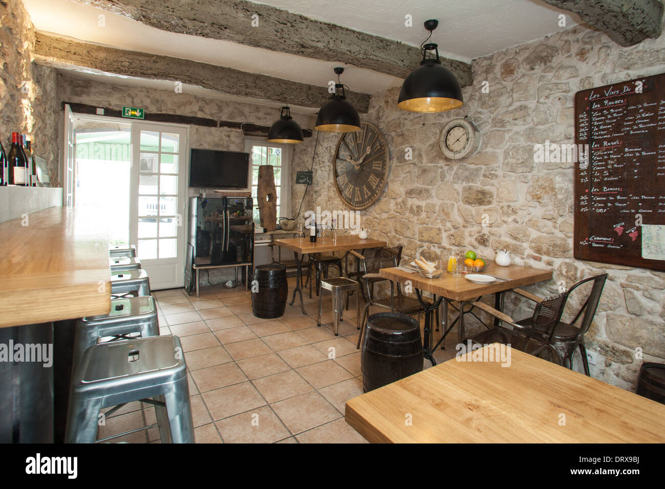 Interior of French bistro with rustic furniture. - Stock Image