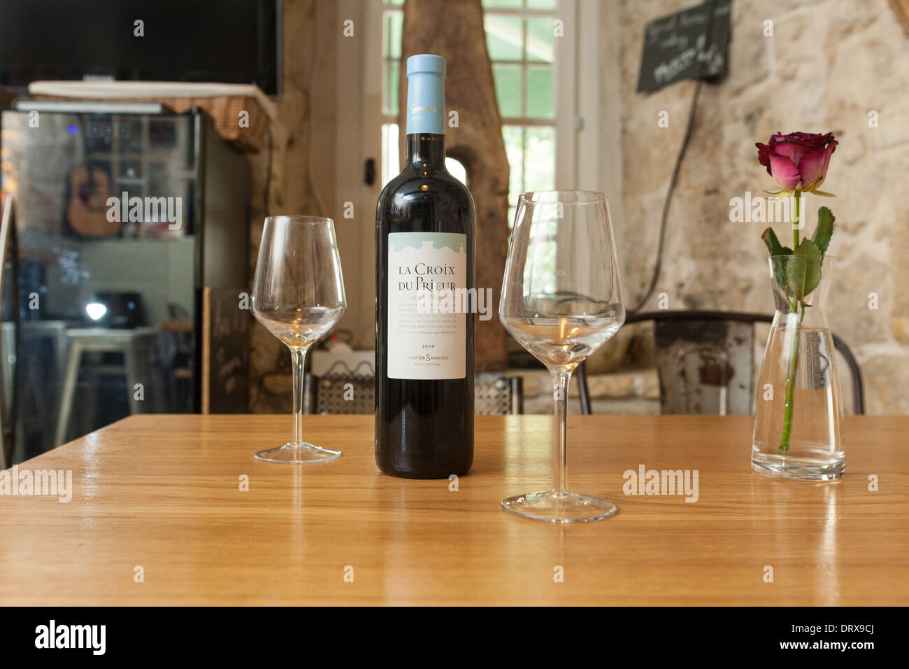 VENCE, FRANCE - SEPTEMBER 16: Table with wine and glasses at Bed and Bistrot on 16 September, 2013 in Vence, France. - Stock Image
