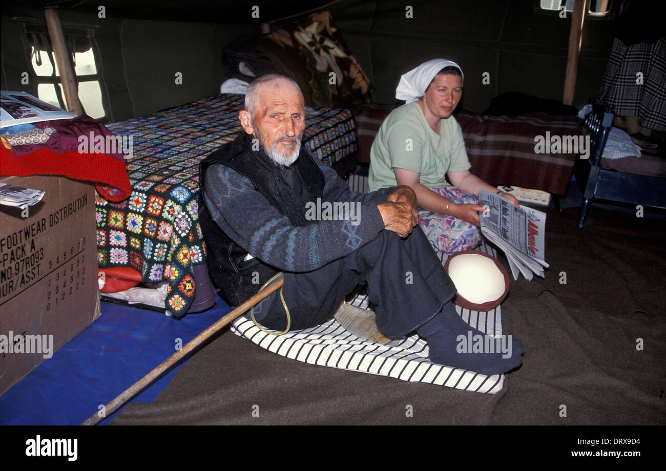 elderly-kosovar-male-refugee-and-daughter-displaced-from-war-in-kosovo-DRX9D4.jpg