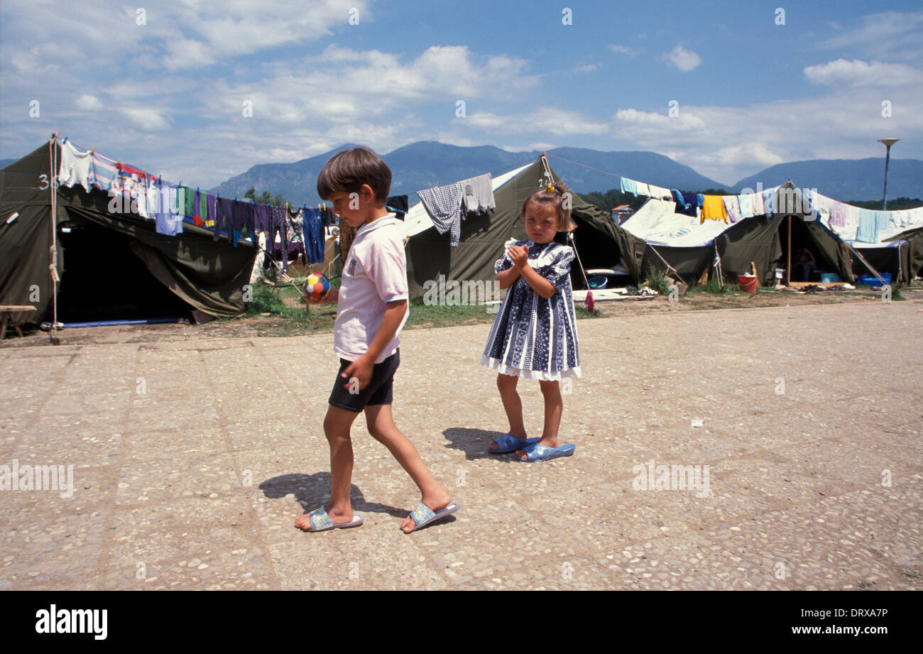 Children in swimming pool refugee camp in Tirana Albania for Kosovar refugees that fled the Kosovan war in 1999 Stock Photo