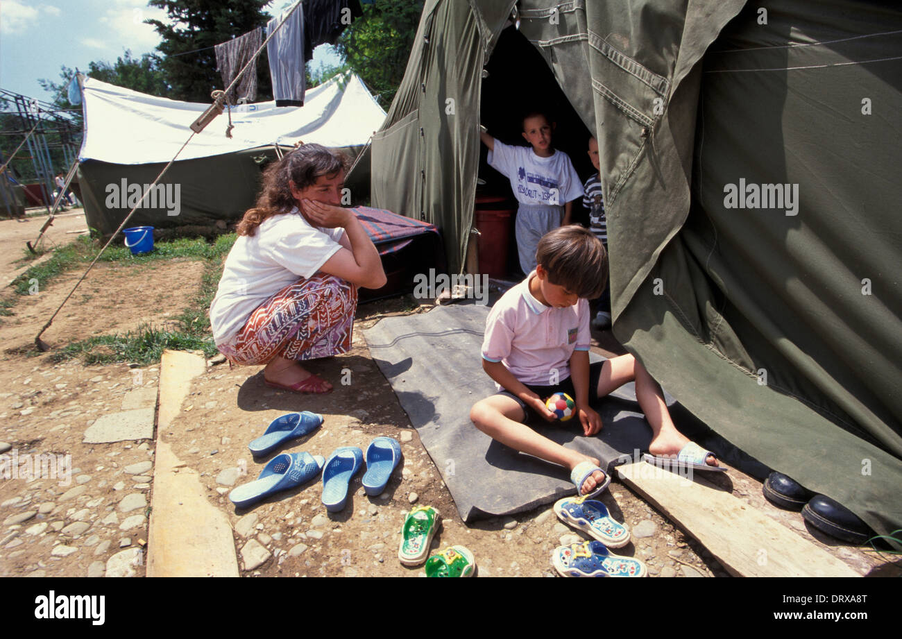 Family at swimming pool refugee camp in Tirana Albania for Kosovar refugees that fled the Kosovan war in 1999 Stock Photo