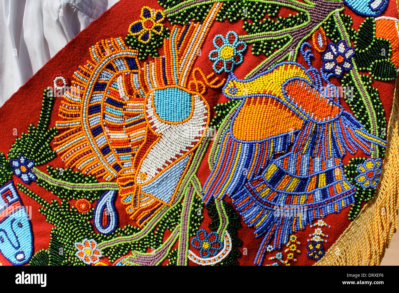 Detail of beaded work on the cape of a Volador de Papantla (Flying Men of Papantla), Mexico - Stock Image