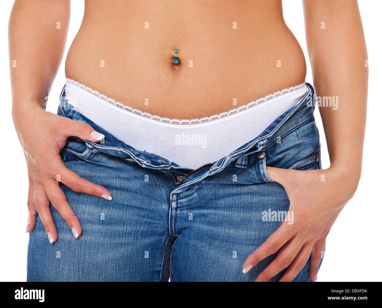 Attractive young woman in bluejeans. All on white background. - Stock Image