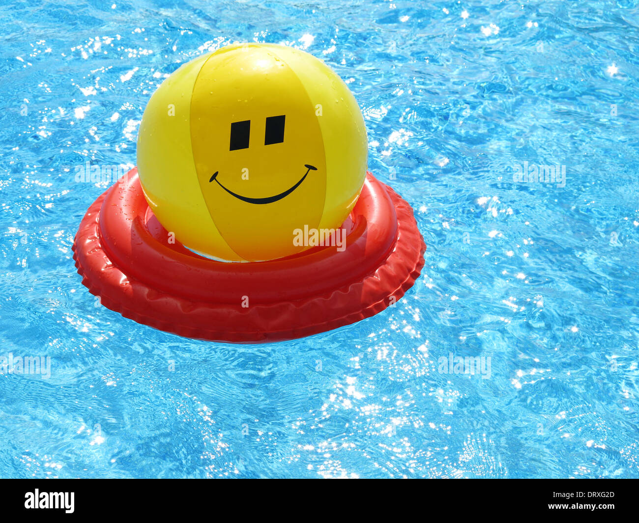 Toys in swimming pool Stock Photo