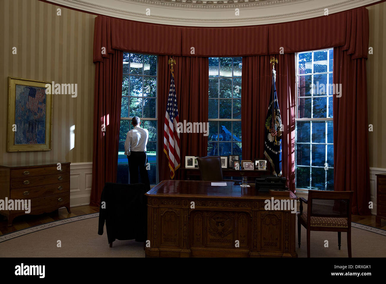 US President Barack Obama looks out the window of the Oval Office of the White House September 17, 2013 in Washington, DC. - Stock Image