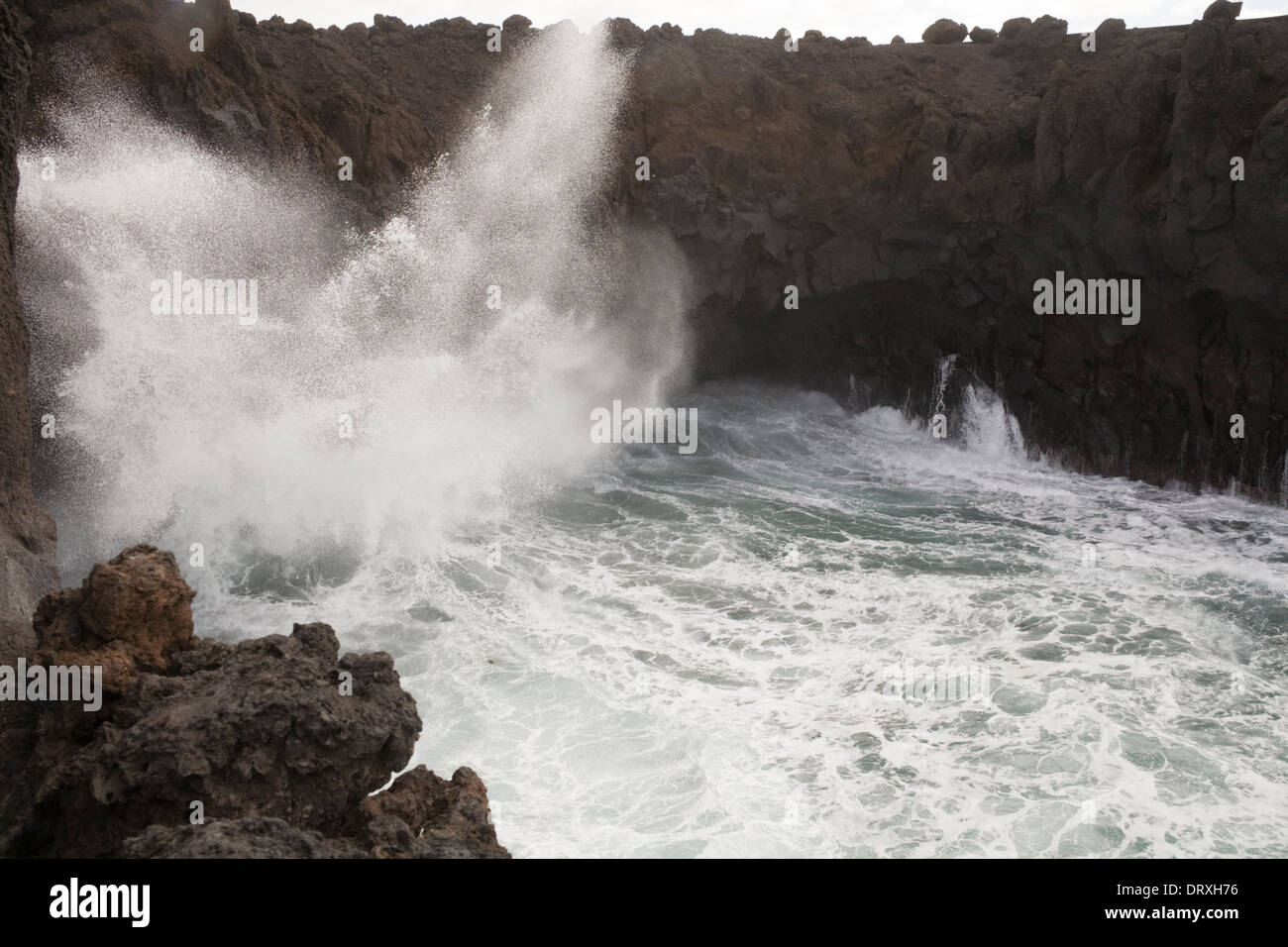 Los Hervideros Boiling Springs Lanzarote Wild Atlantic rollers pounding into sea caves in volcanic lava - Stock Image