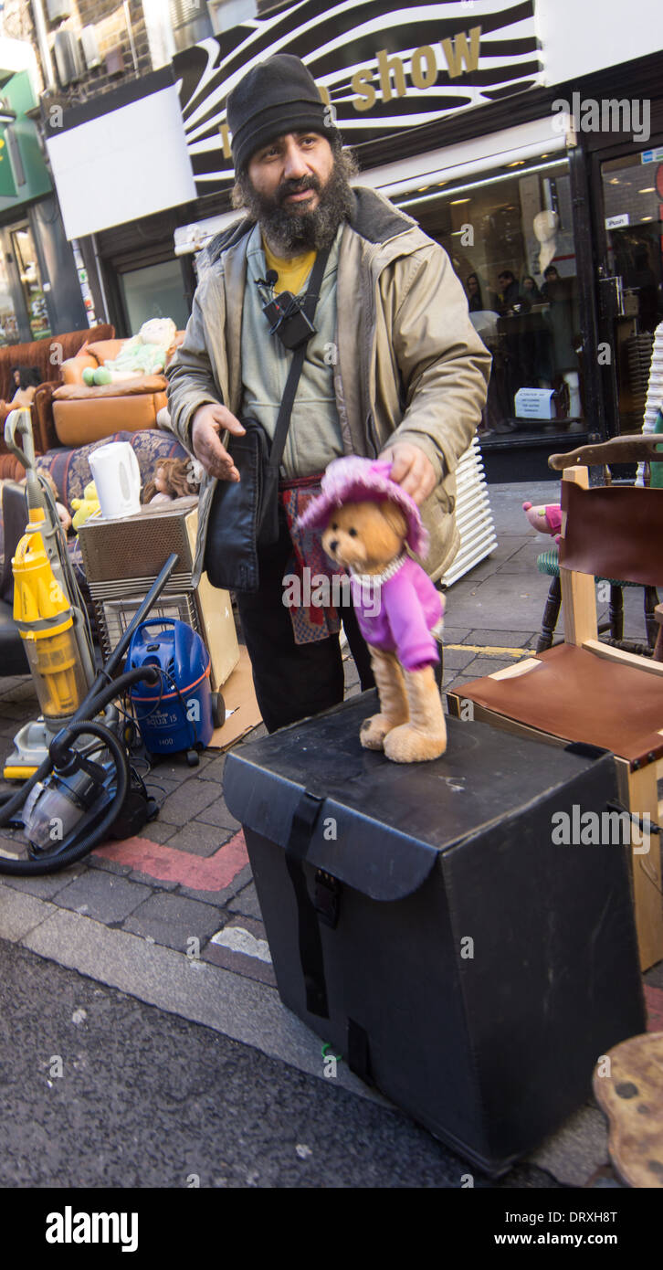 street trader brick lane    stall holder with toy - Stock Image