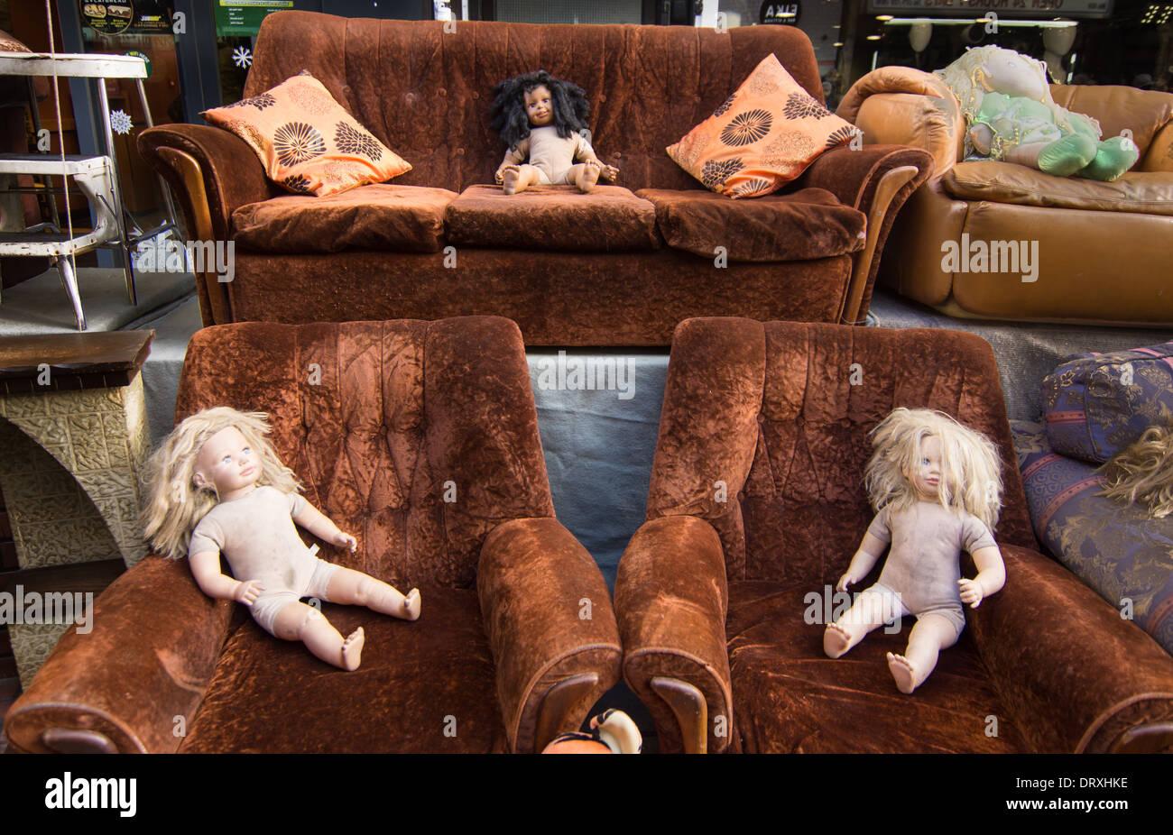 brick lane dolls for sale  strange dolls on sofas - Stock Image