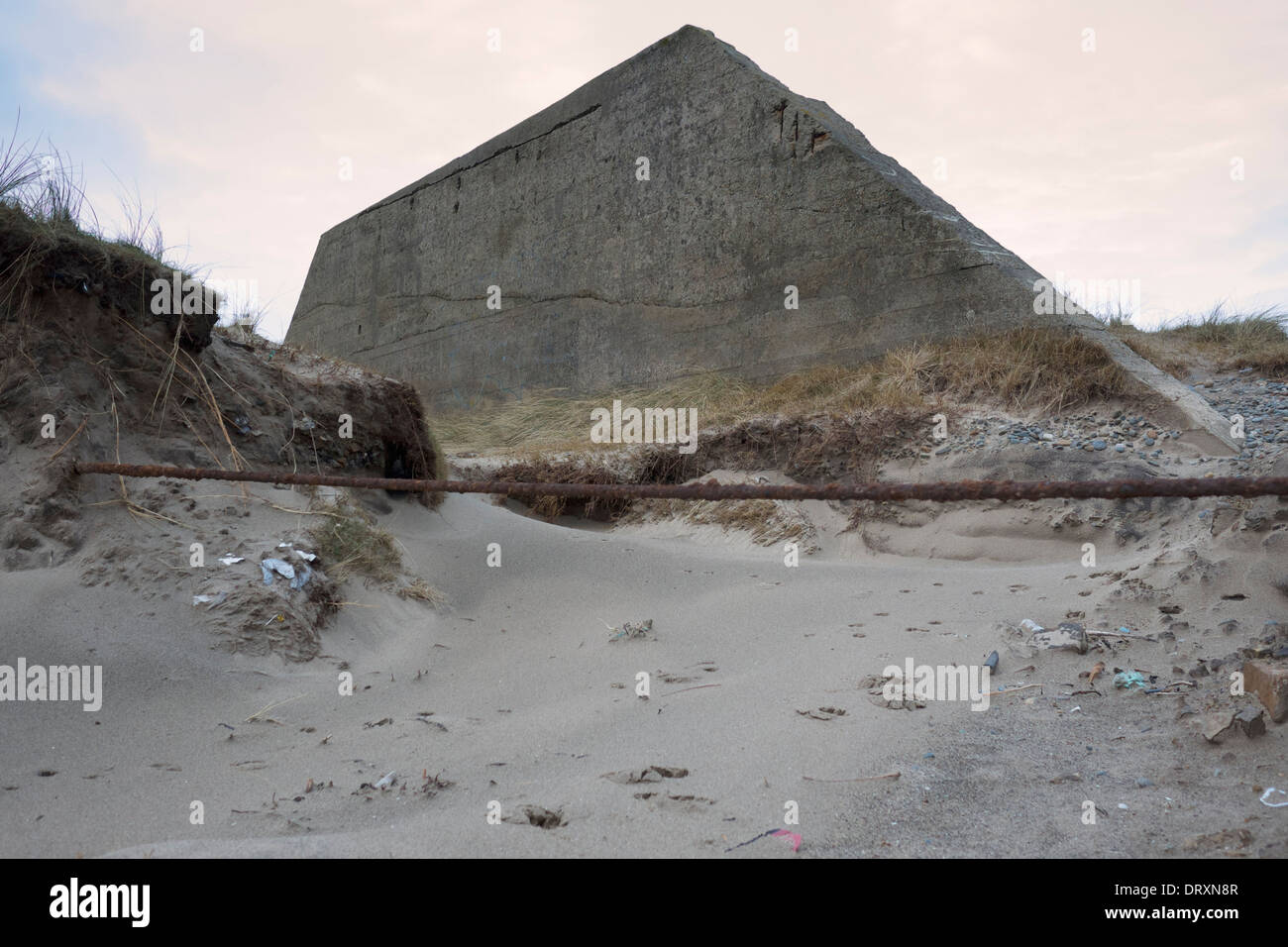World War II Trapezoidal Concrete wall as part of the 200 yard moving target air gunnery training range at Hell's Mouth - Stock Image
