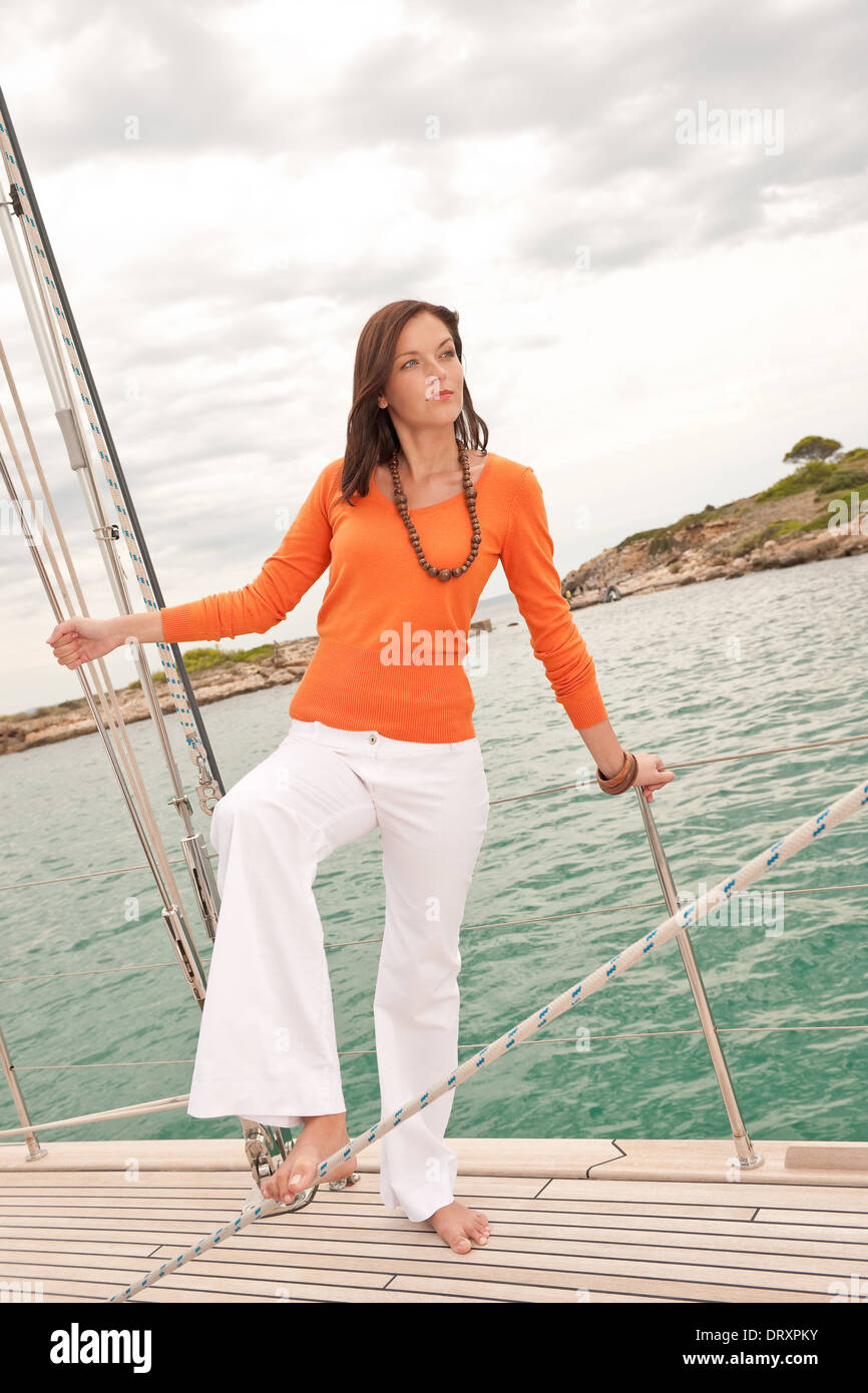 Attractive woman sailing on luxury yacht - Stock Image