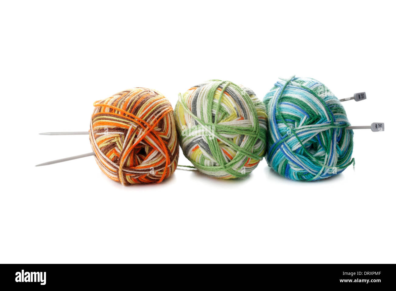 three melange ball of wool and knitting needles on white background - Stock Image
