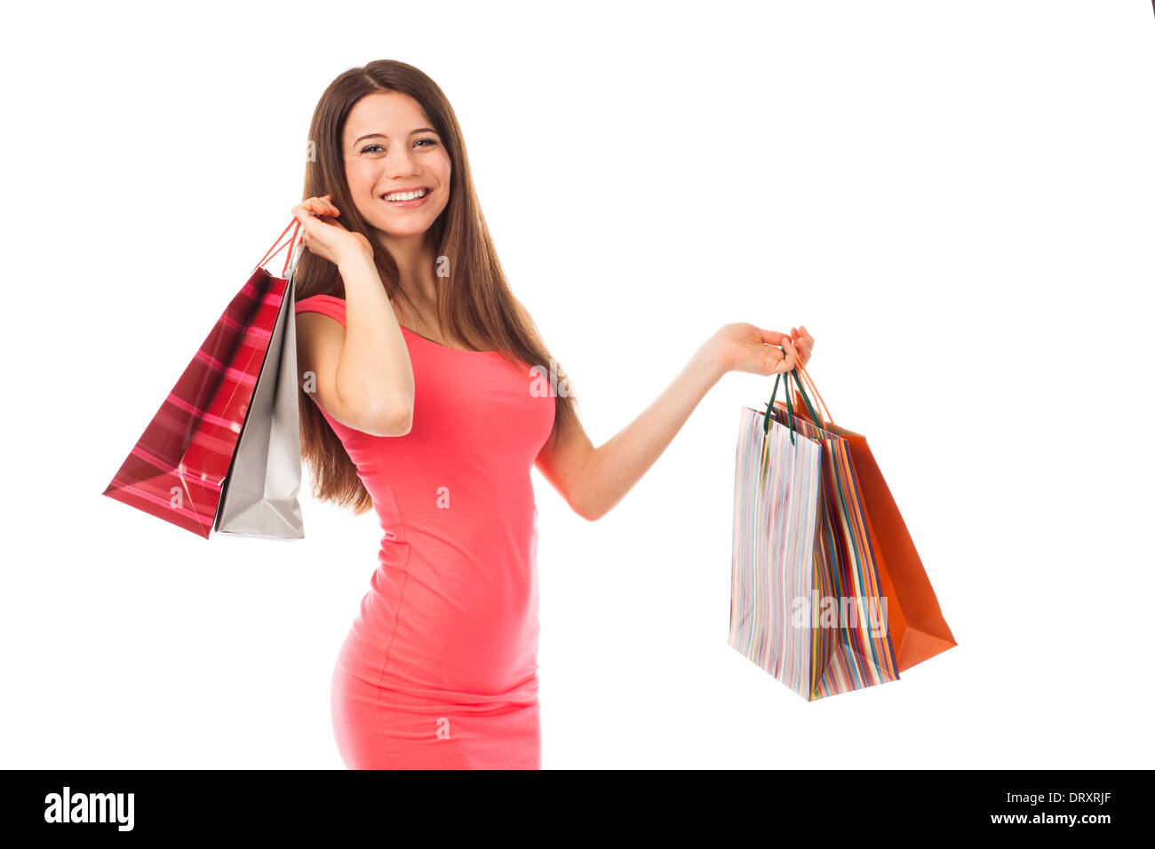 Portrait of a young woman holding shopping bags, isolated on white - Stock Image