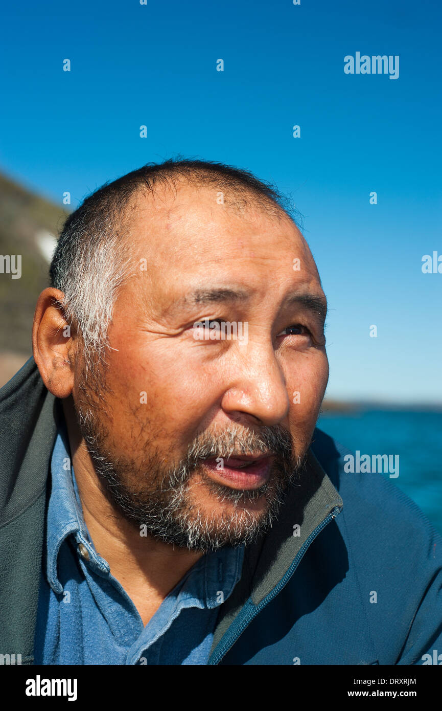Inuit fishing guide from the Canadian Arctic. - Stock Image