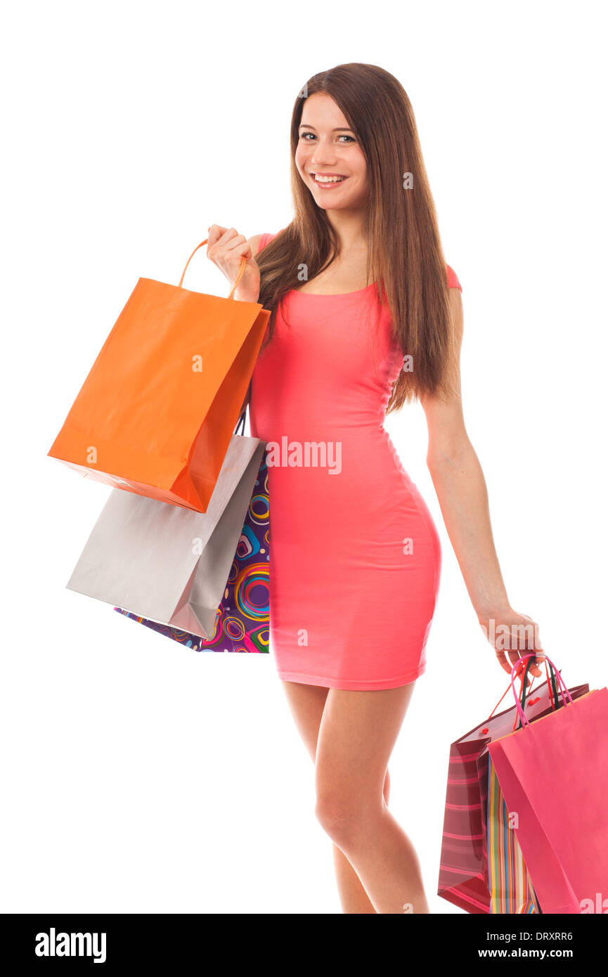 Young smiling woman with shopping bags, isolated on white - Stock Image