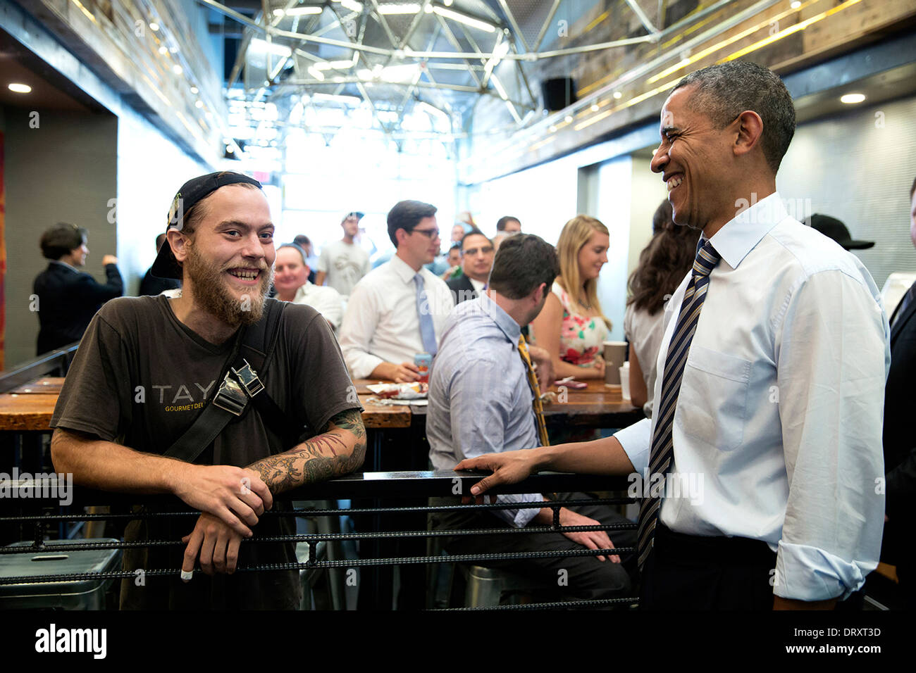 US President Barack Obama talks to an employee at Taylor Gourmet, a sandwich shop near the White House, during a visit to get lunch and thank the shop for offering discounts to furloughed government employees October 4, 2013 in Washington, DC. - Stock Image