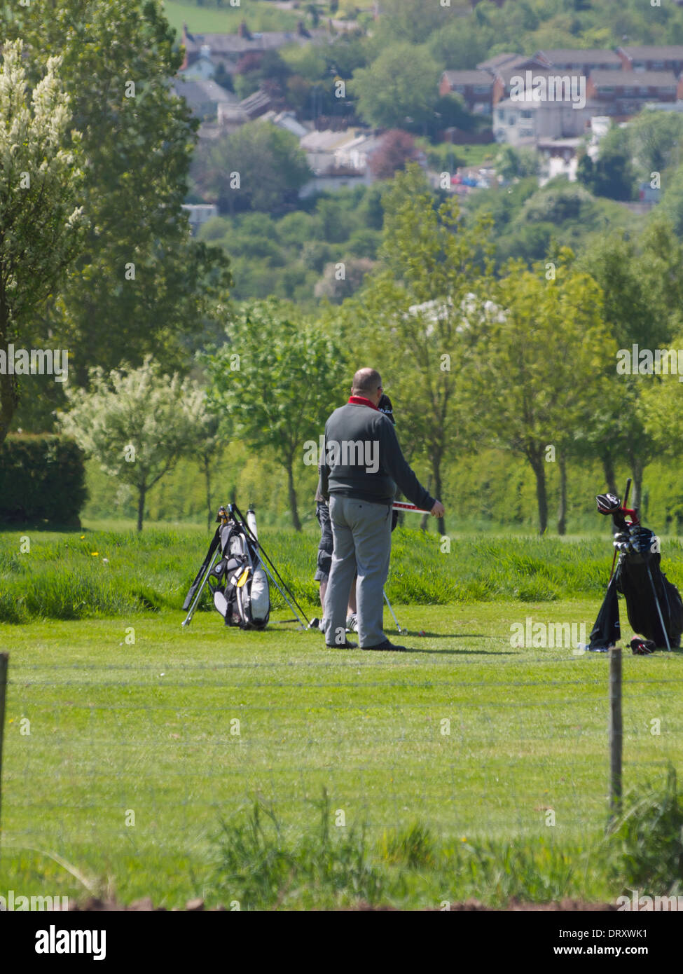 Two (2) golfers waiting to tee off - Stock Image
