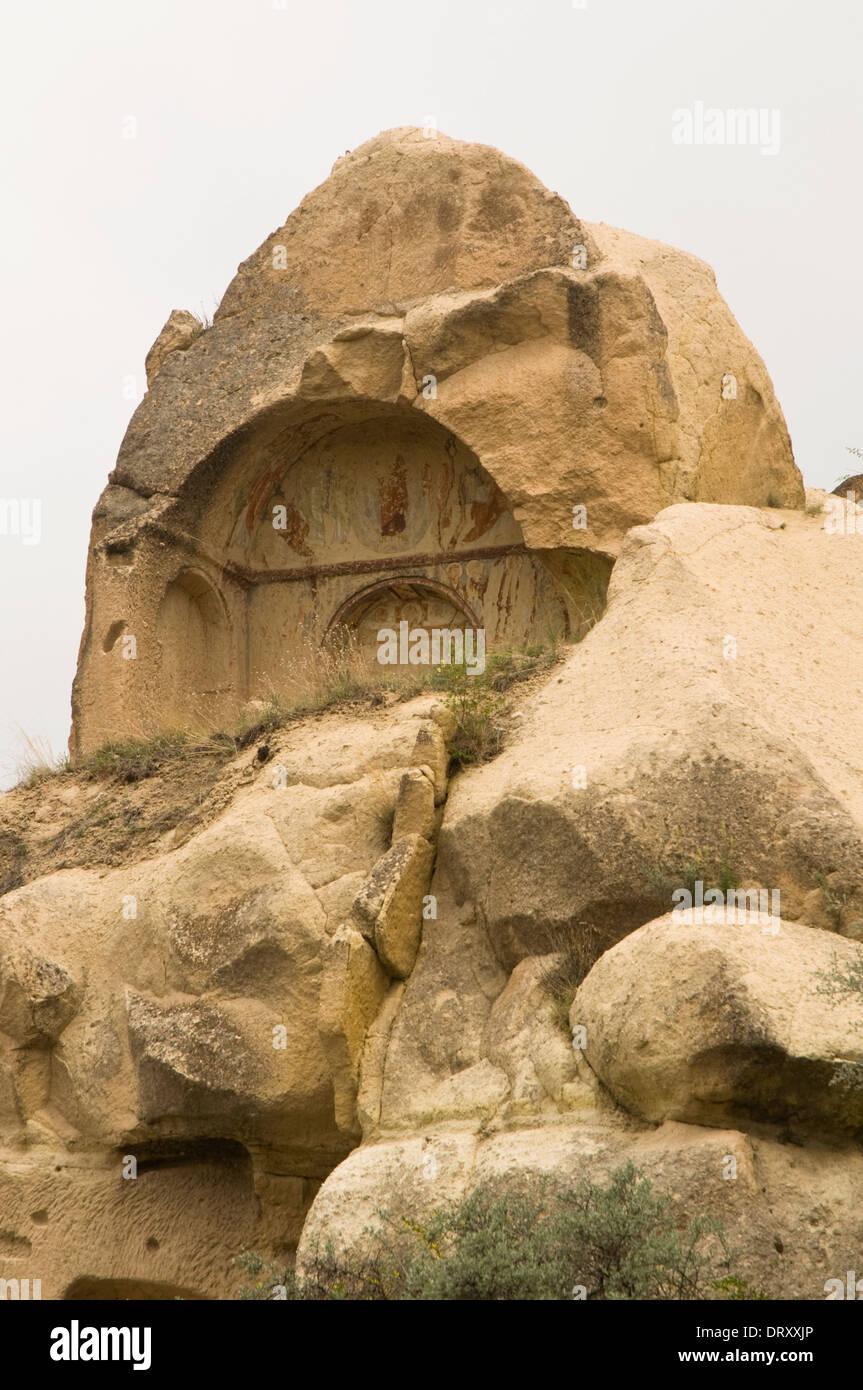 ASIA, Turkey, Cappadocia, Çavuşin, typical Cappadocian scenery with unusual rock formations and chapel set in the rock - Stock Image
