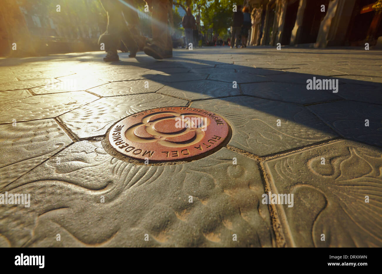Modernism route sign on the Gaudí paving stone design at the Passeig de Gracia avenue. Barcelona. Catalonia. Spain - Stock Image