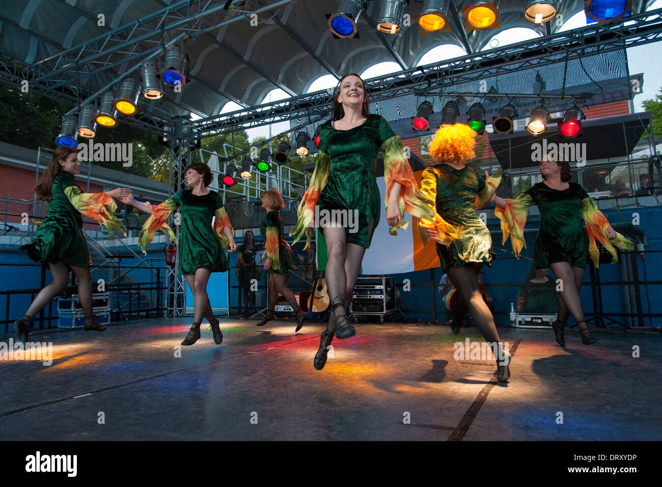 The Irish Dance Ensemble CEILI performs traditional Irish dances on a stage. - Stock Image