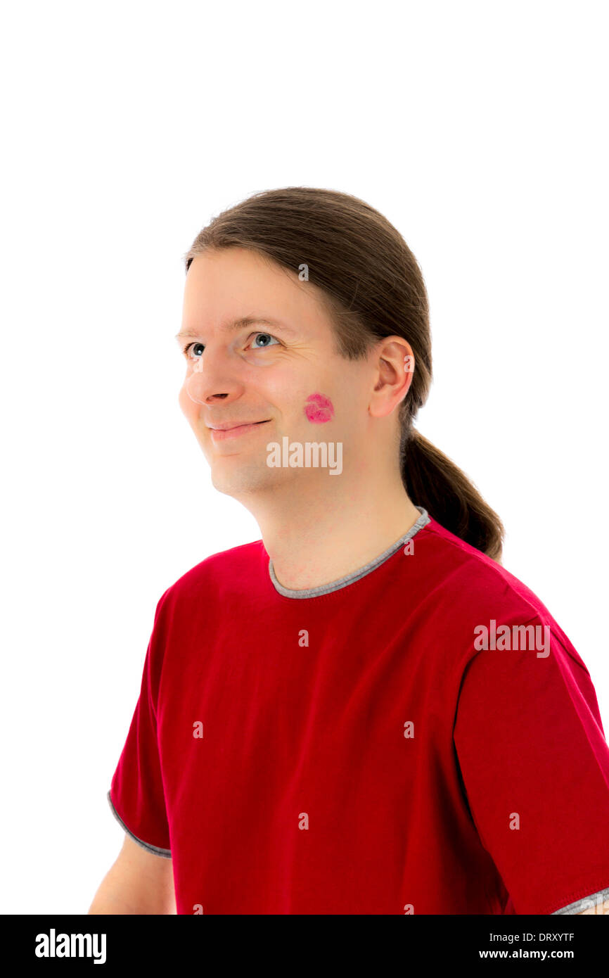 Young man smiling happily because of a kiss for Valentines day and love concept - Stock Image