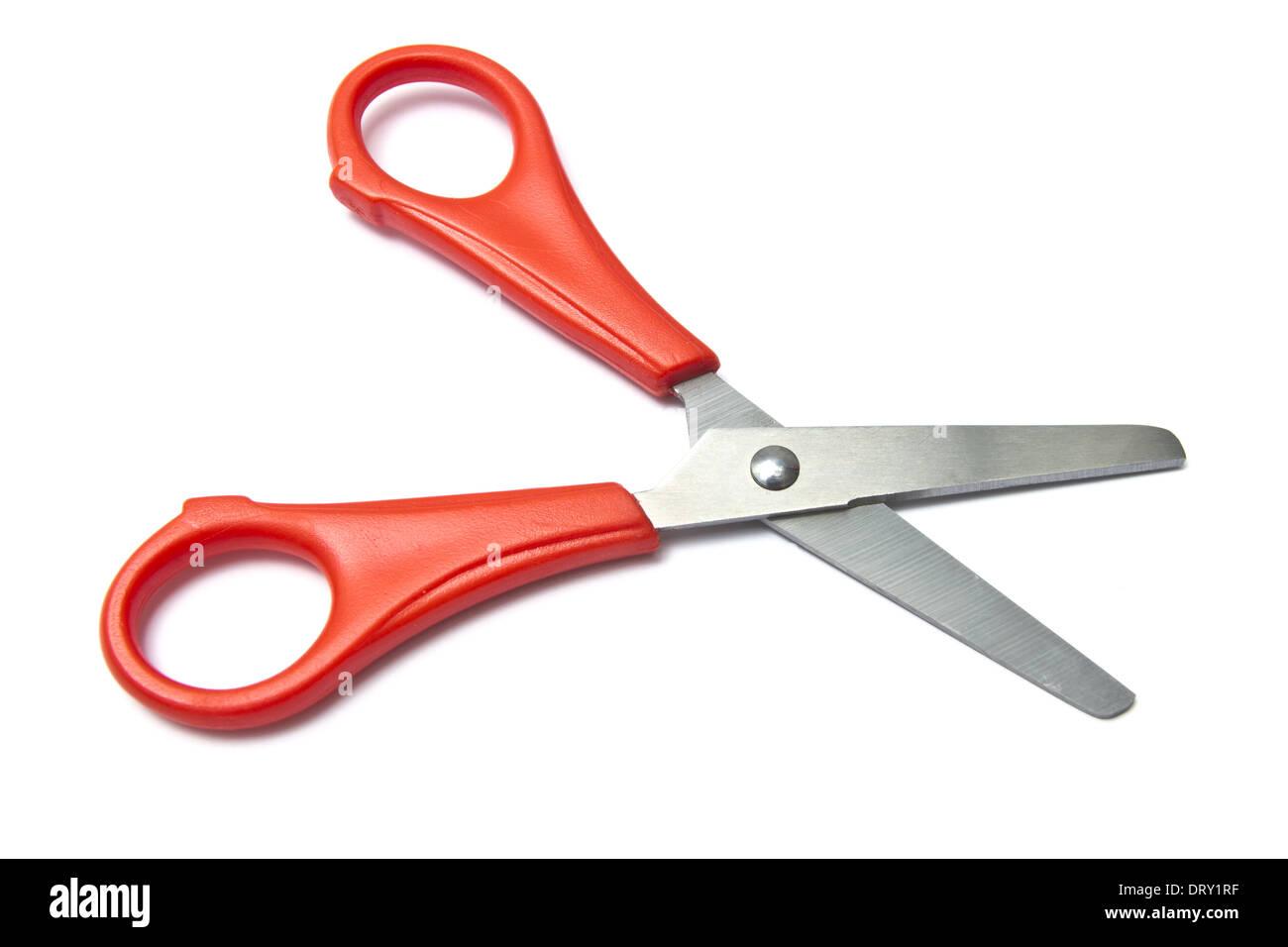 Red handled scissors - Stock Image