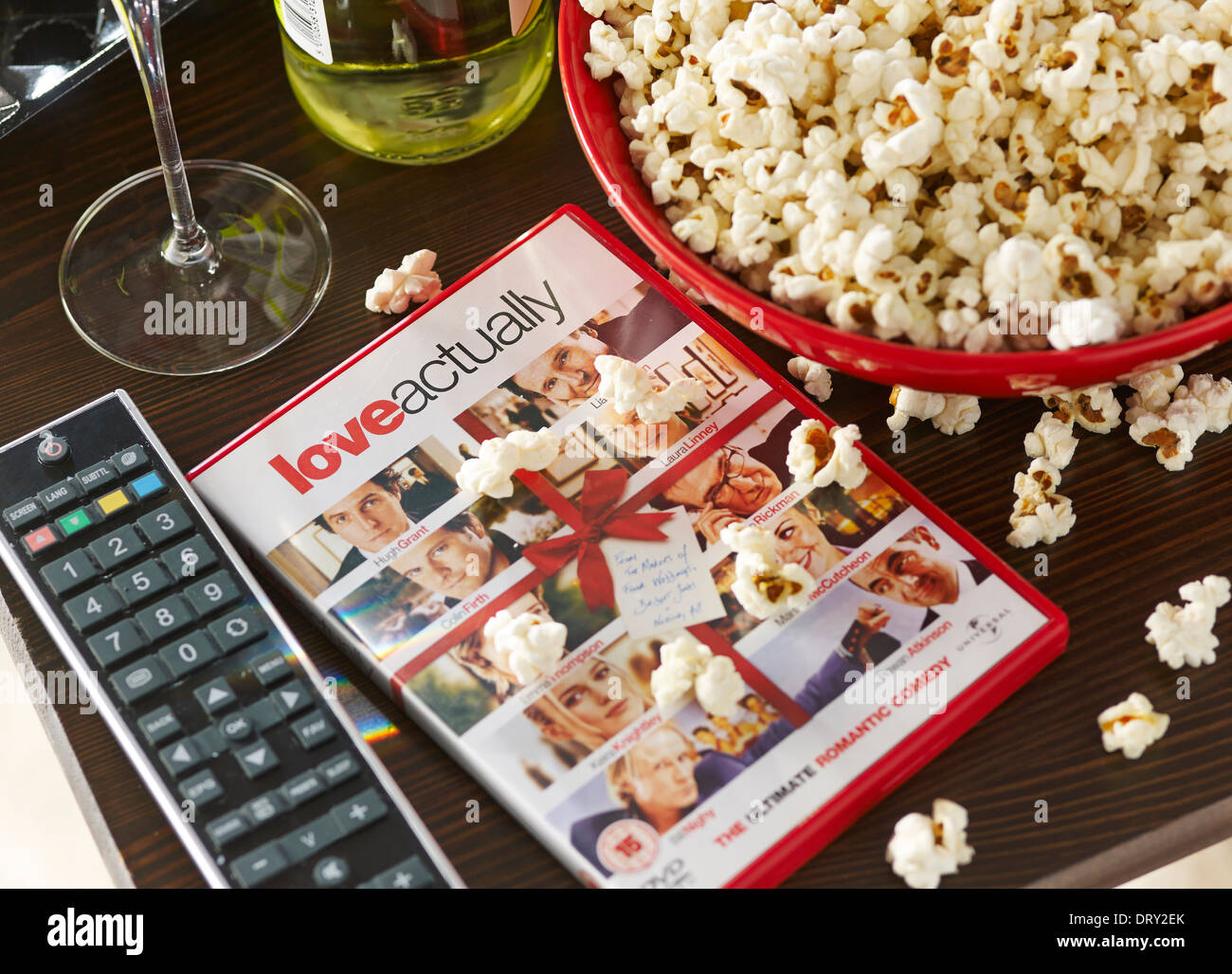 A night in with a DVD and popcorn - Stock Image