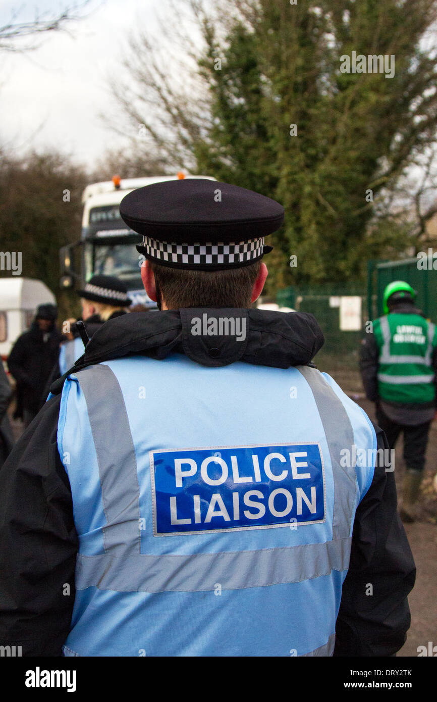Manchester, Barton Moss, UK. 4th February, 2014. Police Liaison Officers & Protestors at IGAS Drilling Site, Greater Manchester Policing operation at Barton Moss Drill Site. Greater Manchester Police called for national help in footing the bill for policing fracking protests and revealed that only 19 of 61 protesters arrested at Barton Moss site  'Camp Barton' are local. There were typically 50 officers required at the site when deliveries were taking place, though as many as 150 officers have been required on a single day. - Stock Image
