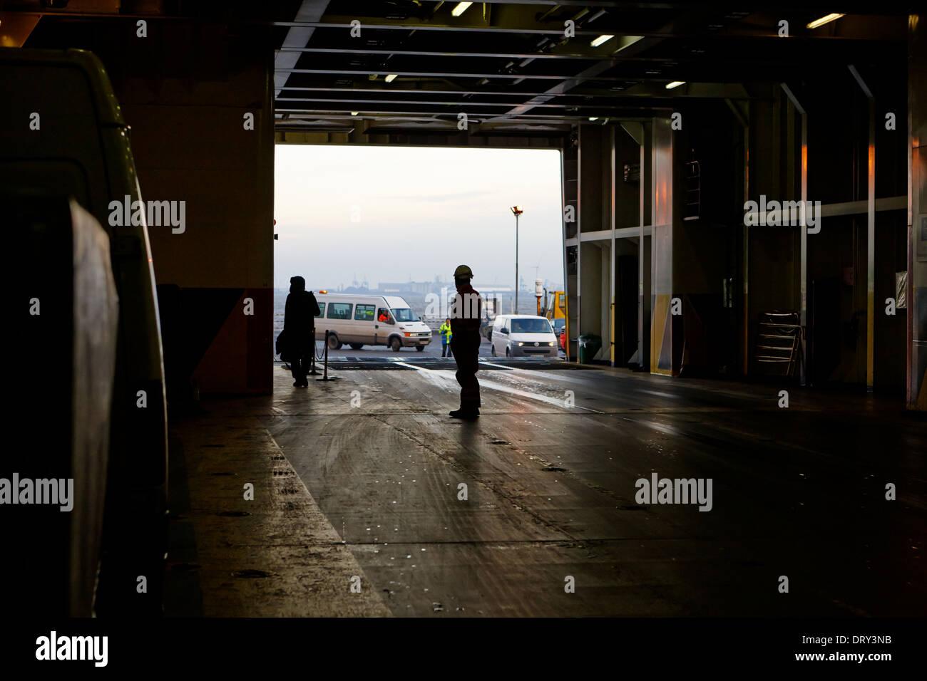 crew members boarding vehicles on irish sea ferry birkenhead merseyside uk - Stock Image