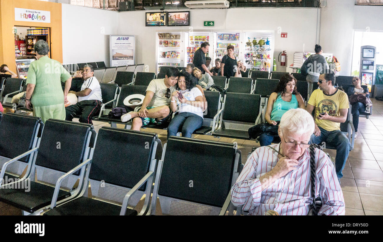 airline passengers in new departure lounge Huatulco airport for travel from lower Pacific coast to US Canada & within Mexico - Stock Image