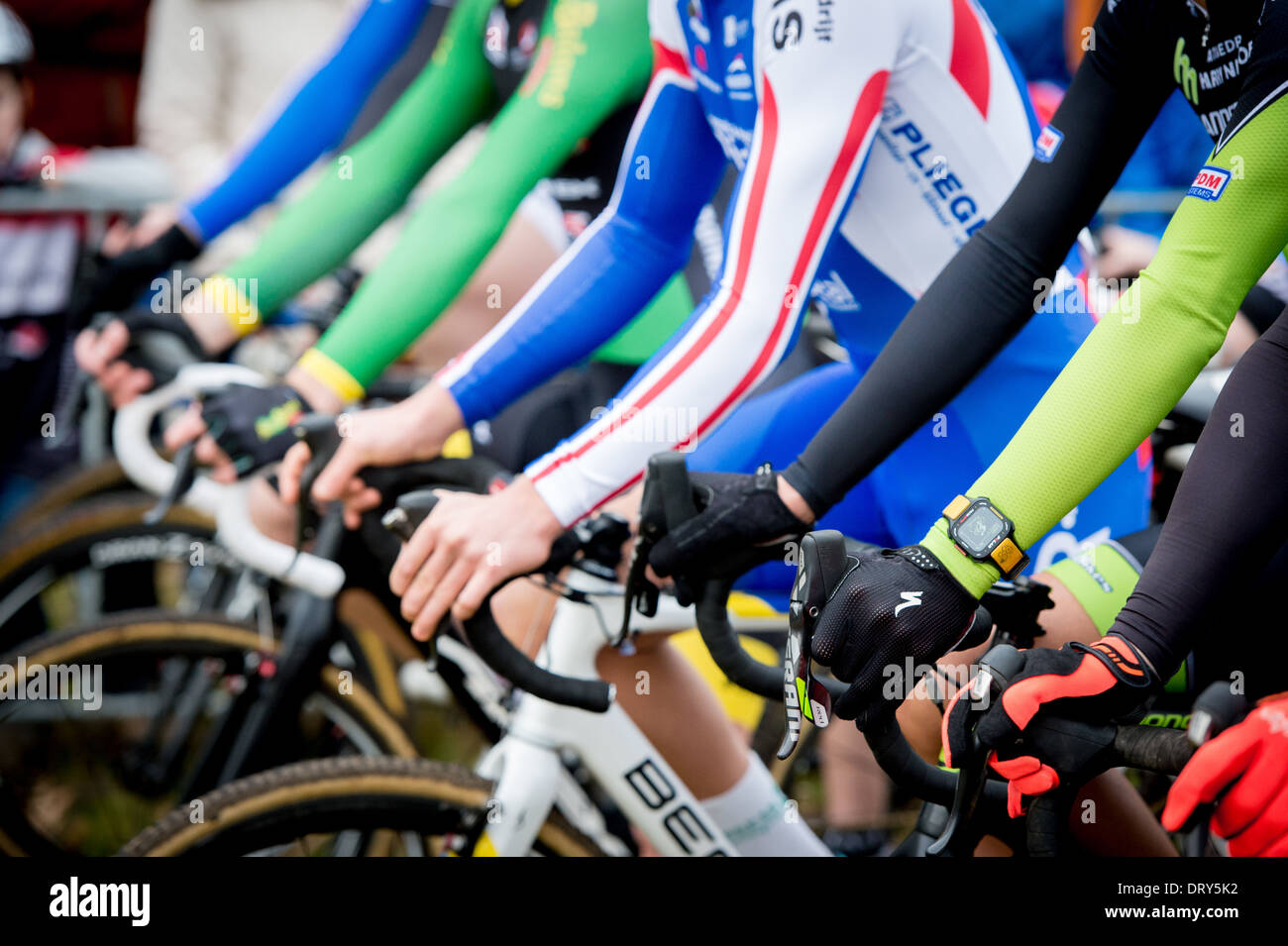 Hands on the handlebars before the start of a cyclocross - Stock Image