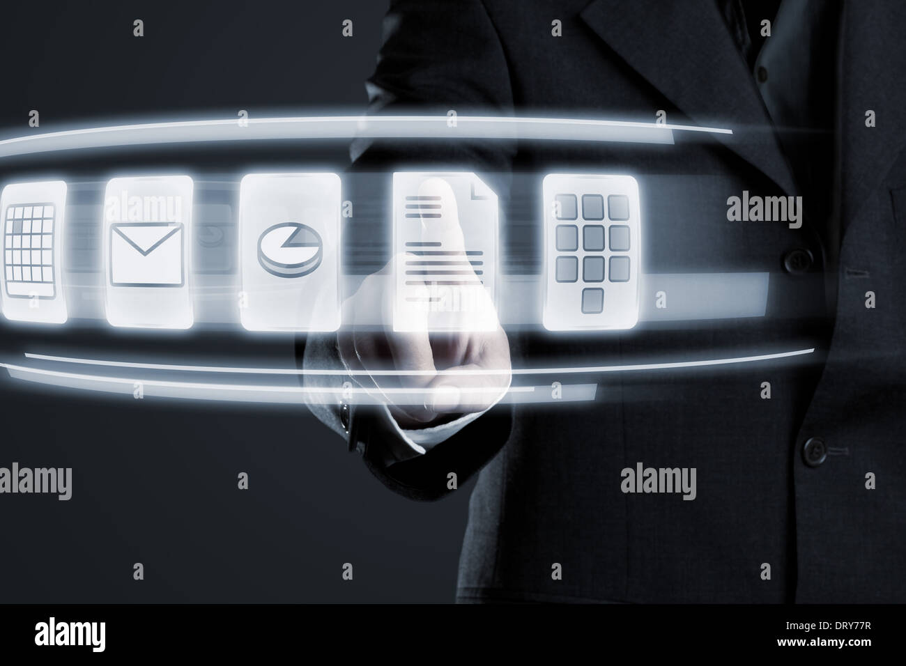 Businessman navigating documents on futuristic touchscreen - Stock Image