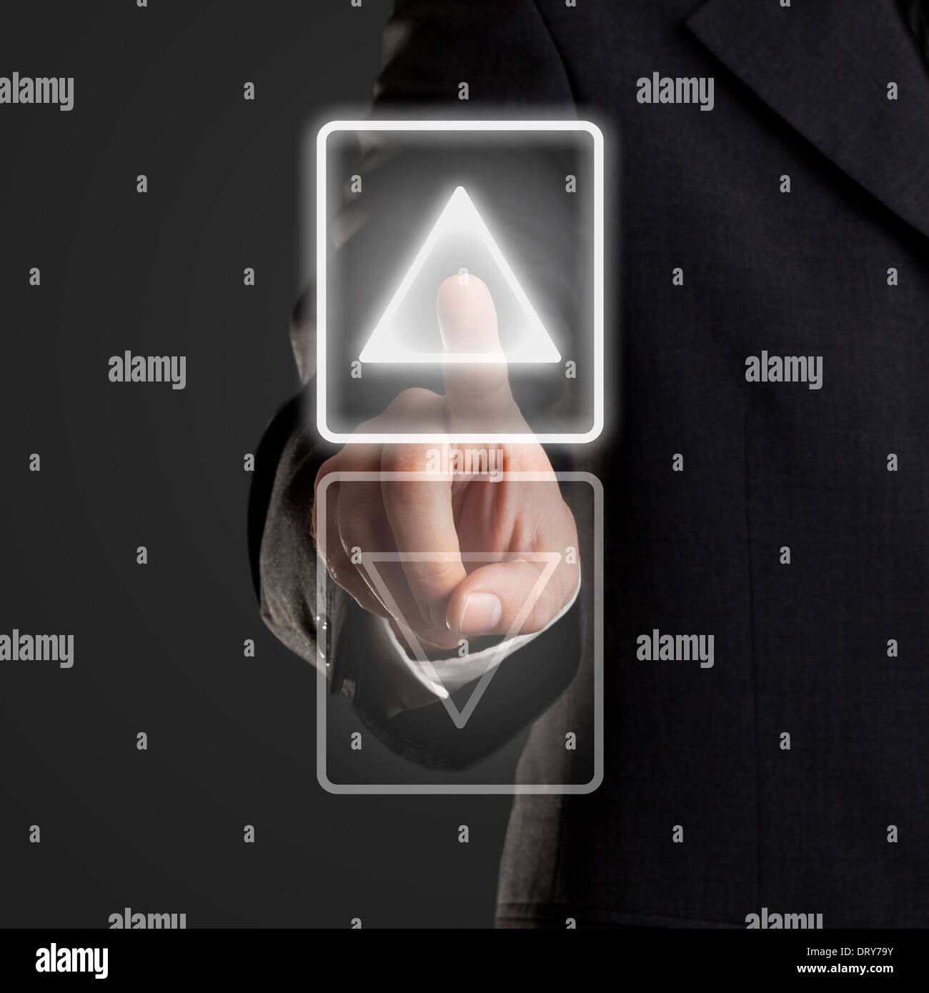 Businessman pressing up button on virtual screen - Stock Image