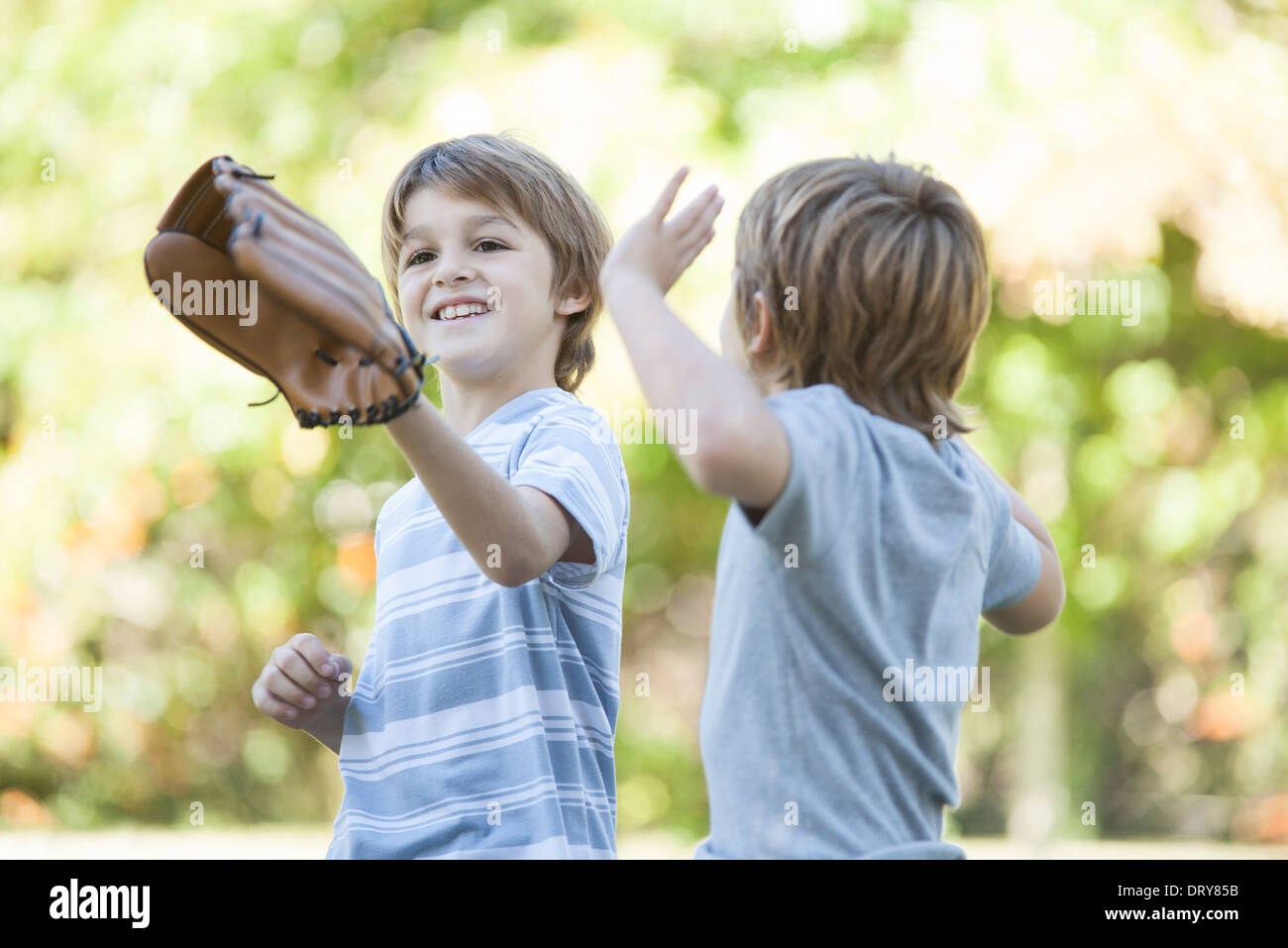 Boy wearing basebal glove - Stock Image
