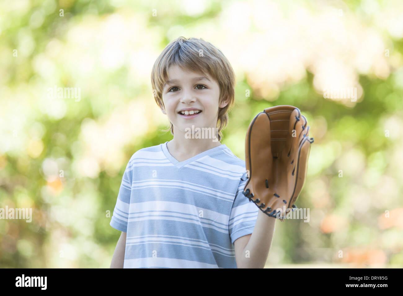 Boy wearing baseball glove - Stock Image